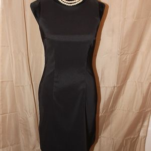 A Classic Black Cocktail Dress with Cardigan